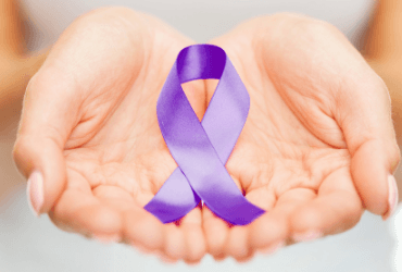 person holding purple domestic violence awareness ribbon