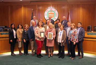 Clerk and Comptroller staff pose with award for excellence in financial reporting